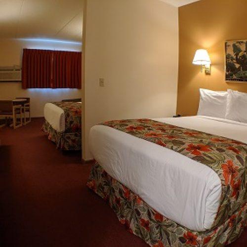2-Queen-Beds-Sofa-Sleeper-Garden-View.jpg